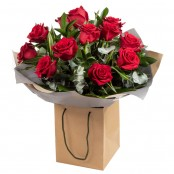 Dozen Red Roses Hand Tied Bouquet presented in Gift Bag