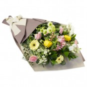 Eden Cut Flowers Gift Wrapped in Brown Paper